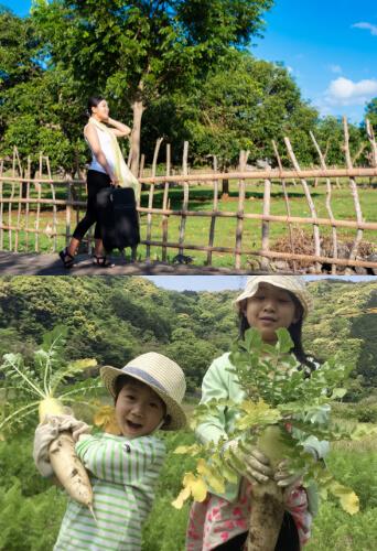 豊かな自然と特産物の野菜を持つ子供たち
